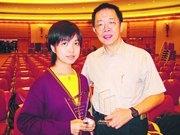 第二次獲得專題報道寫作大獎的顧問老師,佛教善德英文中學陳達生(右),認為獲獎全是同學努力的成果。左為組員之一蔡韋恩同學。